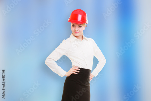 Female engineer woman architect in red safety helmet on blue