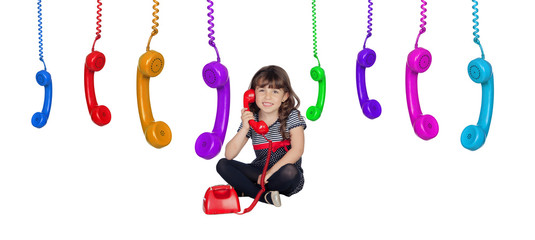 Adorable little girl with many telephones