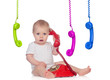 Beautiful baby with many telephones
