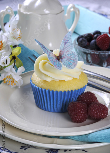 Close up of delicious cupcake with butterfly