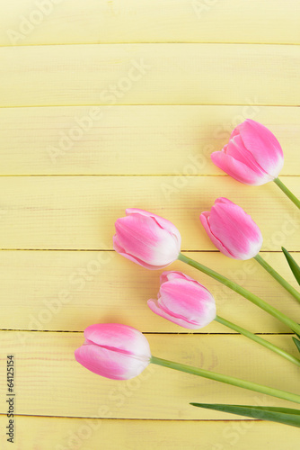 Beautiful tulips in bucket on table close-up