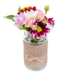 Beautiful bouquet of bright flowers in jar isolated on white