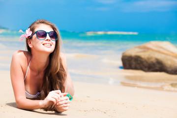 long haired girl in bikini and sunglasses on tropical beach