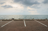 Empty parking lot with seascape poster