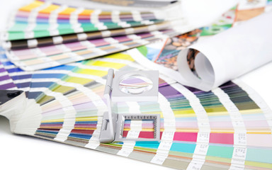 Lens  and pantone. Design and prepress concept