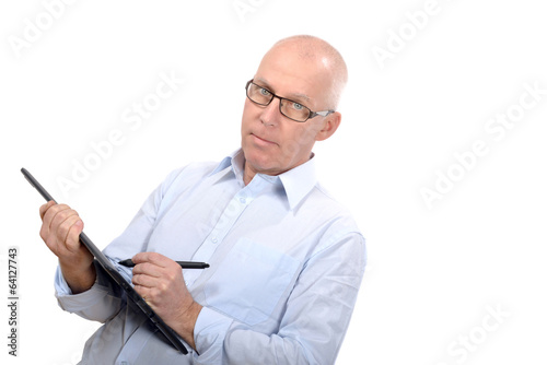 Man standing with a digital tablet