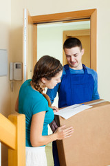 Postman in uniform delivered parcel to housewife