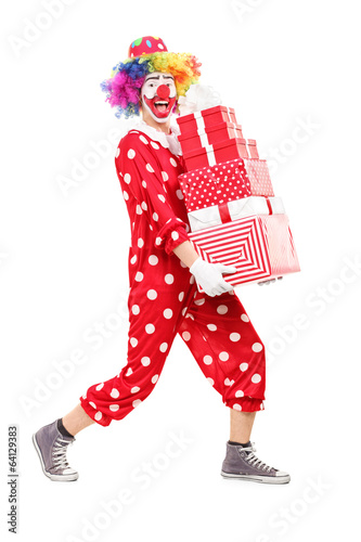 Male clown carrying a pile of presents