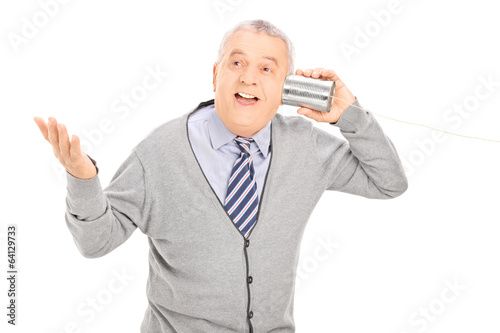 Senior talking through a tin can phone