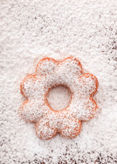 Cookies in the shape of a flower covered powdered sugar