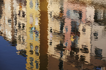 Water reflections of colorful houses.