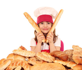 little girl cook with buns bread and pretzel