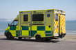 Emergency ambulance on standby at the seafront - 64132306