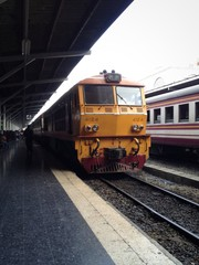 old yellow train in platform