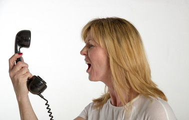 Angry woman shouting into a telephone