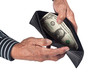 Elderly hands holding a wallet with a dollar in it isolated