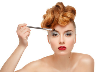 Beauty portrait of pretty woman with brush for makeup