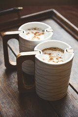 Close-up of two cups of cappuccino