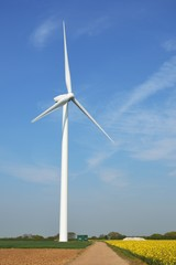 wind turbine standing in field