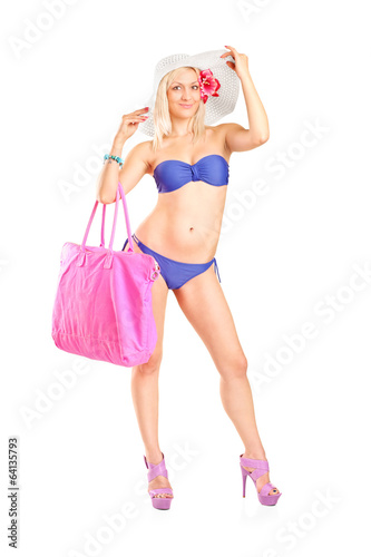 Attractive woman in bikini holding a pink bag