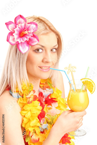Blond female drinking an exotic cocktail