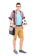 Man carrying a bag and football