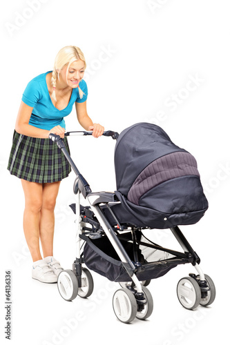 Happy woman looking in a baby stroller
