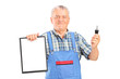 Mature mechanic holding a car key and clipboard