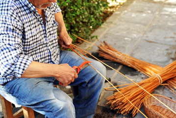 Wicker Craftsman working outdoors, Spain