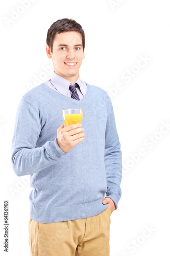 Young man holding a glass of orange juice