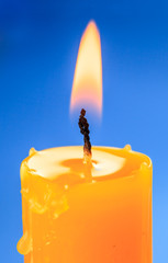 Flame of candle over blue backround