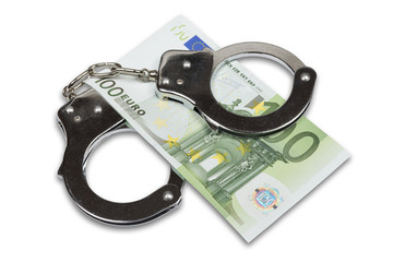 Handcuffs and Euro money isolated over white with clipping path.