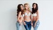 Trio of sexy shapely women in jeans and bras