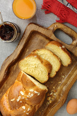 Sweet brioche bread on tray with juice and marmalade