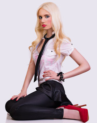 Beautiful fashionable blonde model posing