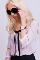 Beautiful blonde model with sunglasses