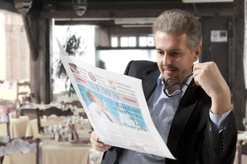 Business man reading a newspape