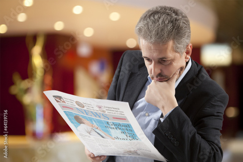 Business man reading a newspape