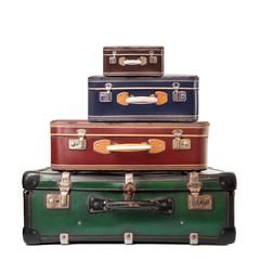 4 valigie vintage in fondo bianco