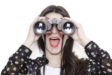 Surprised girl looking through binoculars