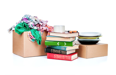 clothing and books cardboard boxes on white background