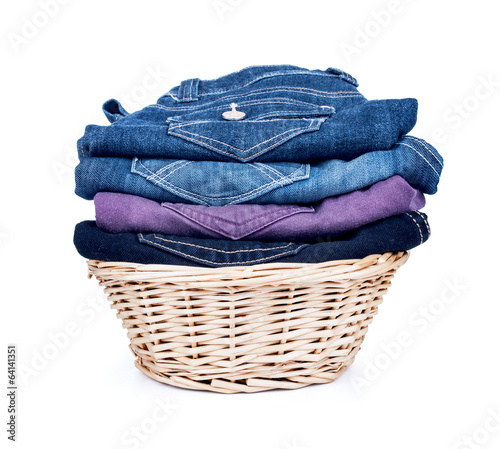 clothes in a wooden basket on isolated white background