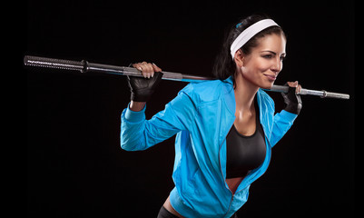 Beautiful young woman exercises with barbell dumbbell Isolated o