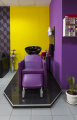 Interior of a beauty salon. Chair-washing in hairdressing salon,