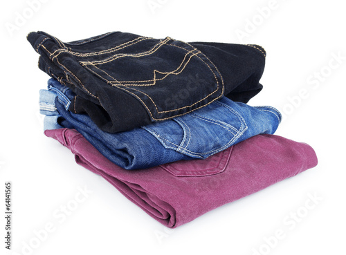 Lot of different blue jeans isolated on white