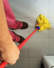 A man cleaning the floor