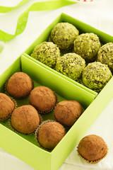 Homemade chocolate truffles and pistachio.