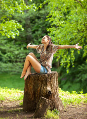 Young attractive woman relaxing  in nature