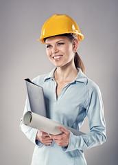 Female architect holding blueprints and folder