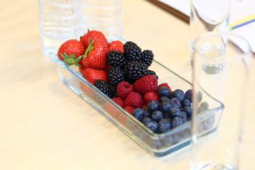 Strawberries, blackberries, raspberries, blueberries in vase